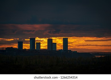 Industrial buildings silhouette against the sky on a sunset. September 8, 2018, Norilsk Talnakh