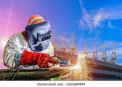 Industrial business concept with technician focus on welding process with equipment protective mask welder, leather gloves, PPE at construction site