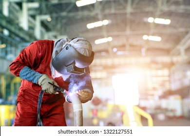 Industrial business concept with technician focus on Tig welding process with equipment protective mask welder, leather gloves, PPE at construction site