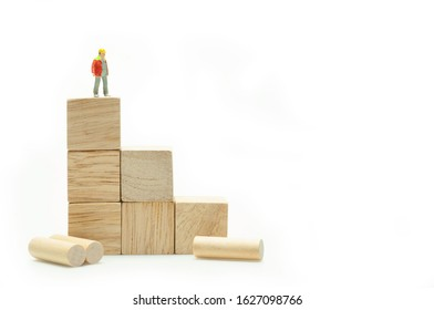 Industrial business growth up strategy, success business people standing on top of stack of wooden cube block.