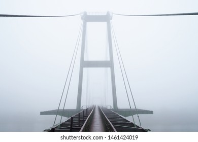 Industrial cable-stayed bridge in thick fog abstract