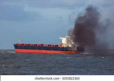 Industrial cargo ship causing air pollution leaving the Port of Rotterdam.