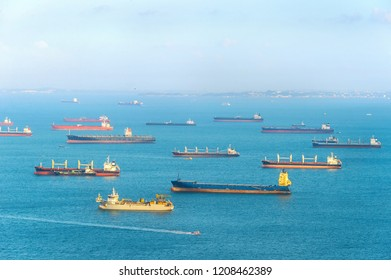 Industrial cargo shipping tankers in Singapore harbor