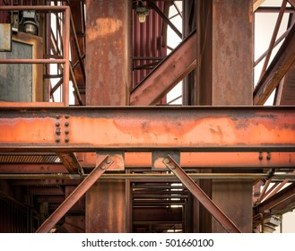 Industrial Cat Walk from abandoned Salt Processing Plant on The Mississippi River with Steel Beams.
