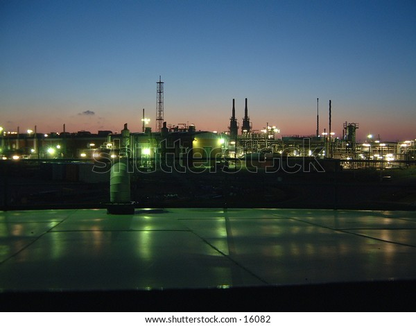 industrial chemical plant backdrop against  night sky