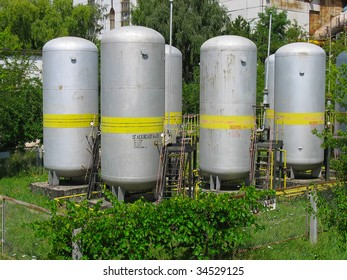 Industrial chemical tanks at a power plant
