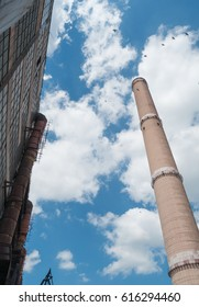Industrial chimney with blue sky background