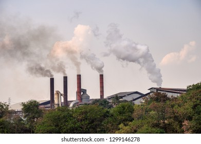 Industrial chimney with smoke pollution emission to atmosphere