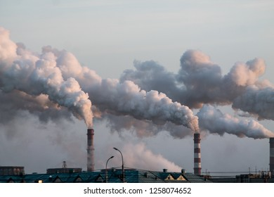 industrial chimneys with heavy smoke causing air pollution problem