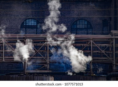 Industrial city. Steam from the working plant. Ukraine, Dnepropetrovsk