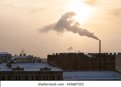 Industrial cityscape with big factory smoke winter rooftop ciyscape