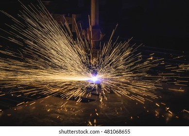 Industrial CNC plasma cutting of metal plate in construction industry.