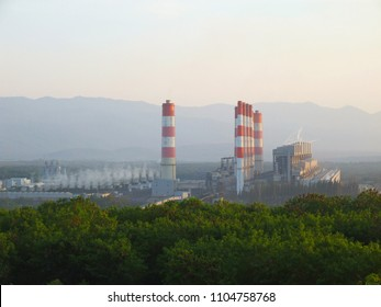 Industrial coal power plant with smokestack. Electric power generating station.