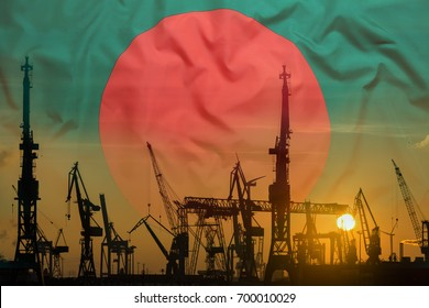 Industrial concept with Bangladesh flag at sunset, silhouette of container harbor