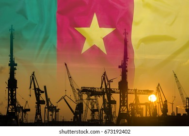 Industrial concept with Cameroon flag at sunset, silhouette of container harbor