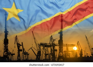 Industrial concept with Congo flag at sunset, silhouette of container harbor
