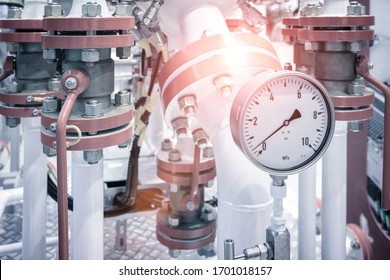 Industrial  concept. equipment of the boiler-house, - valves, tubes, pressure gauges, thermometer. Close up of manometer, pipe, flow meter, water pumps and valves of heating system in a boiler room.