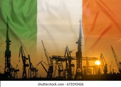 Industrial concept with Ireland flag at sunset, silhouette of container harbor
