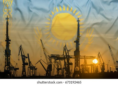 Industrial concept with Kazakhstan flag at sunset, silhouette of container harbor