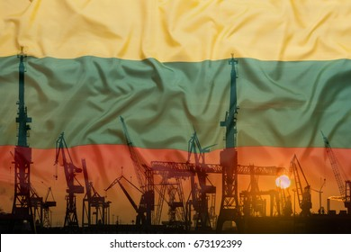 Industrial concept with Lithuania flag at sunset, silhouette of container harbor