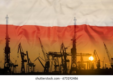 Industrial concept with Poland flag at sunset, silhouette of container harbor