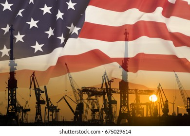 Industrial concept with United States flag at sunset, silhouette of container harbor