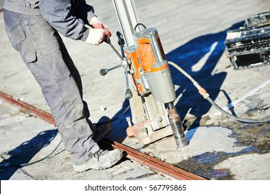 industrial concrete drilling at construction demolition work