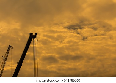 Industrial construction crane isolated on sky background in yellow