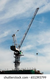 Industrial construction cranes and building.