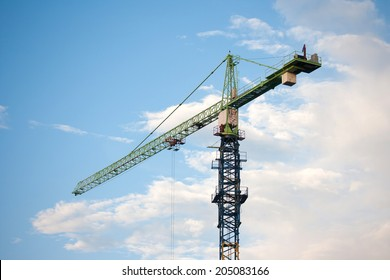Industrial construction cranes on sky background