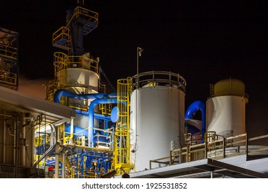 Industrial construction and equipment at night