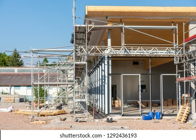 Industrial construction site of a supermarket with scaffold