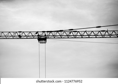 industrial construction tower cranes against blue sky in the background - concept business real estate work erection technology building site progress architecture development. black and white color