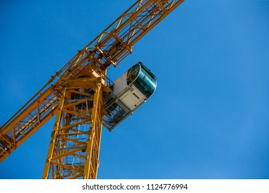 industrial construction tower cranes against blue sky in the background - concept business real estate work erection technology building site progress architecture development. closeup control room