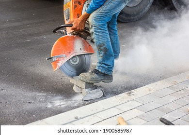 Industrial construction worker using a professional angle grinder.Industrial construction worker using a professional angle grinder.