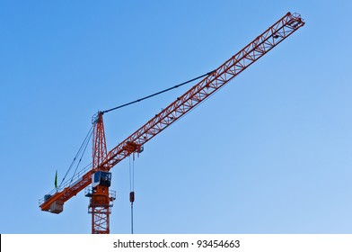 Industrial construction: yellow crane against blue sky