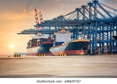 Industrial Container Cargo freight shipping by crane Logistic Import Export in shipyard at sunset time