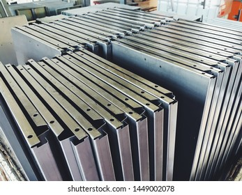 Industrial conveyor line at the factory for metal parts. Pretreatment of the surface of parts and paint parts with powder paint.