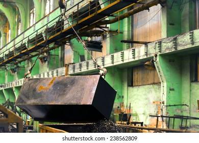 Industrial crain closeup photo indoors in blue