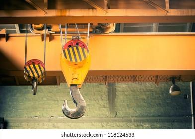 Industrial crane hook in a building