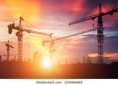 industrial crane silhouette with sunset