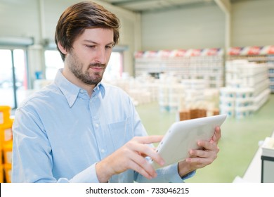 industrial and decorating shop manager using tablet
