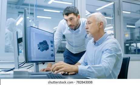 Industrial Designer Has Conversation with Senior Engineer While Working in CAD Program, Designing New Component. He Works on Personal Computer with Two Monitors.