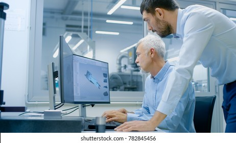 Industrial Designer Has Discussion with Senior Engineer While Working in CAD Program, Designing New Component. He Works on Personal Computer with Two Monitors.