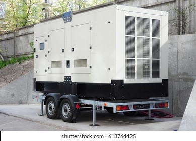 Industrial Diesel Generator. Standby generator. Industrial Diesel Generator for Office Building connected to the Control Panel with Cable Wire. Backup Generator Power.