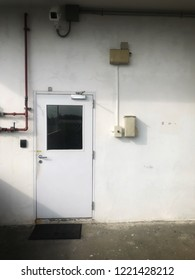 industrial door with damper with red pipe line and cctv security camera with white background