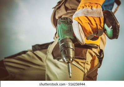 Industrial Drilling Equipment in Hand of Construction Worker.
