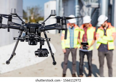 Industrial drone operators on work site