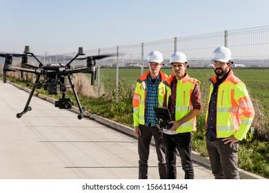 Industrial drone operators on work site