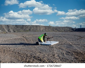 Industrial drone pilot operating a drone at a diamond mine in Botswana